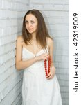 pretty girl with red beads... | Shutterstock . vector #42319009