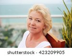 Small photo of Portrait of beauty middle aged woman in the park