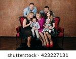 three generation family sitting ... | Shutterstock . vector #423227131