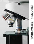 side of microscope on gray - stock photo