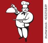 chef holding domed platter | Shutterstock .eps vector #423251839