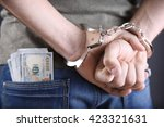 Man In Handcuffs With Dollar...