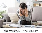 shocked woman at home checking... | Shutterstock . vector #423338119