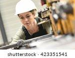 woman with helmet working in... | Shutterstock . vector #423351541