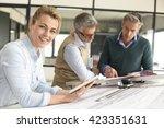 team of engineers working... | Shutterstock . vector #423351631