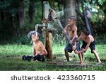 the boys are playing with water ... | Shutterstock . vector #423360715