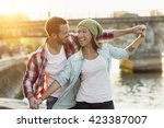 young couple visiting paris | Shutterstock . vector #423387007