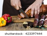 hand closeup cuts ham and... | Shutterstock . vector #423397444