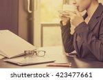 business woman drinking coffee... | Shutterstock . vector #423477661