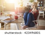 freelancer working at home... | Shutterstock . vector #423496801