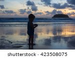 boy at beach | Shutterstock . vector #423508075
