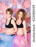 two pregnant girlfriends in... | Shutterstock . vector #423585439