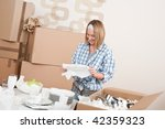 moving house  happy woman... | Shutterstock . vector #42359323