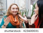 young women talking and... | Shutterstock . vector #423600031