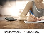 pen in hand and woman in... | Shutterstock . vector #423668557