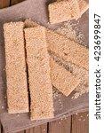 simple homemade sesame bars... | Shutterstock . vector #423699847