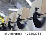 cardboard boxes on conveyor... | Shutterstock . vector #423803755
