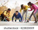 group of friends doing push ups ... | Shutterstock . vector #423820009