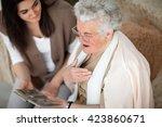 Grandma Showing Old Photo Albu...