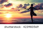 yoga silhouette at surreal... | Shutterstock . vector #423983569