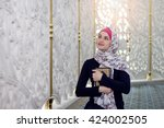 woman praying in the mosque and ... | Shutterstock . vector #424002505