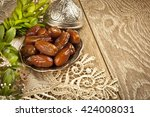 dried date palm fruits or kurma ... | Shutterstock . vector #424008031