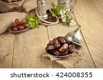 dried date palm fruits or kurma ... | Shutterstock . vector #424008355