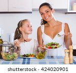cheerful woman and little girl... | Shutterstock . vector #424020901