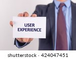 man showing paper with user... | Shutterstock . vector #424047451