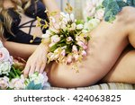 Young Woman Sits On Couch With...