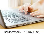 woman working at home office... | Shutterstock . vector #424074154