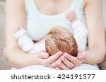 motherhood. newborn baby on... | Shutterstock . vector #424191577
