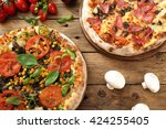 top view pizza on kitchen table ... | Shutterstock . vector #424255405