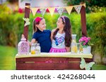 two young girls at their... | Shutterstock . vector #424268044