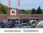 Small photo of AYWAILLE, BELGIUM - MAY 6, 2016: Parking and entry of a Delhaize supermarket, part of Ahold Delhaize Group, an Dutch-Belgian international food retailer