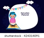 cute islamic boy reading holy... | Shutterstock .eps vector #424314091