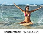 female surfer in the water ... | Shutterstock . vector #424316614