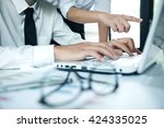 business working with laptop in ... | Shutterstock . vector #424335025