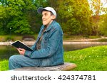 disabled man reading a book in... | Shutterstock . vector #424374781