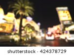Stock photo scene on the road at night in las vegas nevada usa blurred 424378729