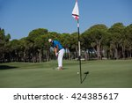 golf player hitting shot with...   Shutterstock . vector #424385617
