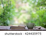 notebook with pencil and cup on ... | Shutterstock . vector #424435975