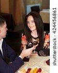 couple toasting wineglasses    Shutterstock . vector #424456861