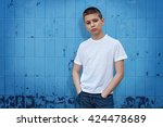 boy standing in front of blue... | Shutterstock . vector #424478689