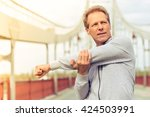handsome middle aged man in... | Shutterstock . vector #424503991