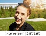 headshot of happy pretty... | Shutterstock . vector #424508257
