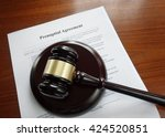 prenup agreement on a desk with ... | Shutterstock . vector #424520851