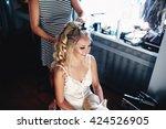 hairdresser is doing a... | Shutterstock . vector #424526905