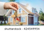 keys in hands on house... | Shutterstock . vector #424549954