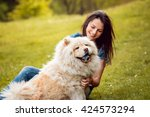 Stock photo young woman with the dogs in the park 424573294